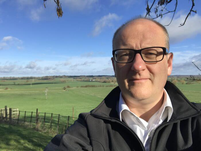 David Roberts shares his thoughts on the move from fossil fuels to a cleaner, healthier environment. Image shows David Roberts, MD of Nu-Heat, with a fresh blue and green spring countryside image behind him.
